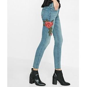 Express blue jeans with rose embroidery